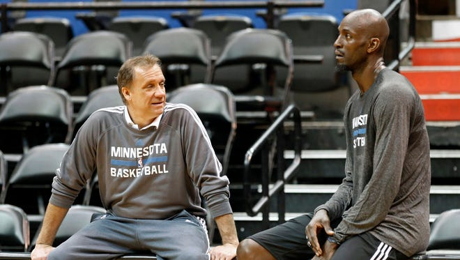 Timberwolves star Kevin Garnett, right, talks with head coach Flip Saunders after his first practice upon his return to the team Feb. 24, 2015.