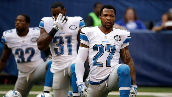 Detroit Lions safety Glover Quin (27) and teammates stretch before a game Sept. 11, 2016.