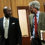 Hattiesburg Mayor Johnny DuPree, left, and special counsel John Scanlon talk during a Nov. 13 'settlement conference' at Marion County Circuit Court about  Petal's suit against Hattiesburg concerning sewer rates.