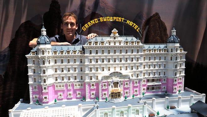 Ryan Ziegelbauer stands behind his Lego Grand Budapest Hotel.