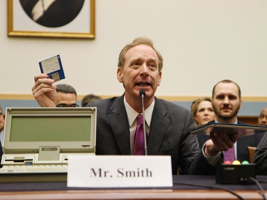 Brad Smith, president and chief legal officer at Microsoft Corp., explains how much technology has changed in the last three decades to a House committee.