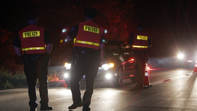 North Castle police conduct a DWI checkpoint on Route 128 near Wampus Pond in Armonk.