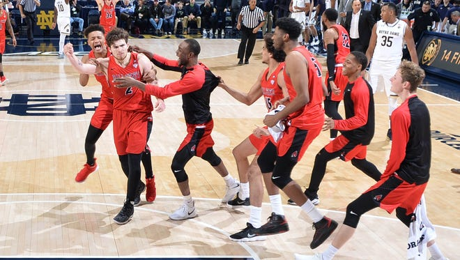 Dec 5, 2017; South Bend, IN, USA; Ball State Cardinals guard Tayler Persons (2) celebrates with his teammates after making the game winning shot in the second half against the Notre Dame Fighting Irish at the Purcell Pavilion. Mandatory Credit: Matt Cashore-USA TODAY Sports