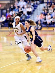 Hartland's Nikki Dompierre (10) tries to dribble past