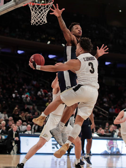Purdue guard Carsen Edwards (3) passes off the ball around Penn State forward Lamar Stevens (11) during the second half of an NCAA Big Ten Conference tournament semifinal college basketball game, Saturday, March 3, 2018, in New York. Purdue won 78-70. (AP Photo/Julie Jacobson)