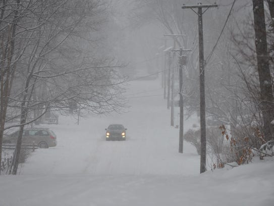 A car makes its way up a hill on Brewer Parkway in