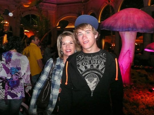 This undated photo provided by Jennifer Weiss-Burke on Sept. 12, 2016 shows her and her son, Cameron Weiss. Weiss-Burke said his descent into drug addiction started with an opioid prescription a doctor wrote for him for a wrestling injury. After his death from a heroin overdose in 2011, Weiss-Burke pushed for a bill limiting initial prescriptions of opioid painkillers for acute pain to seven days. The bill exempted people with chronic pain, but opponents still fought back, with lobbyists for the pharmaceutical industry quietly mobilizing in increased numbers to quash the measure.