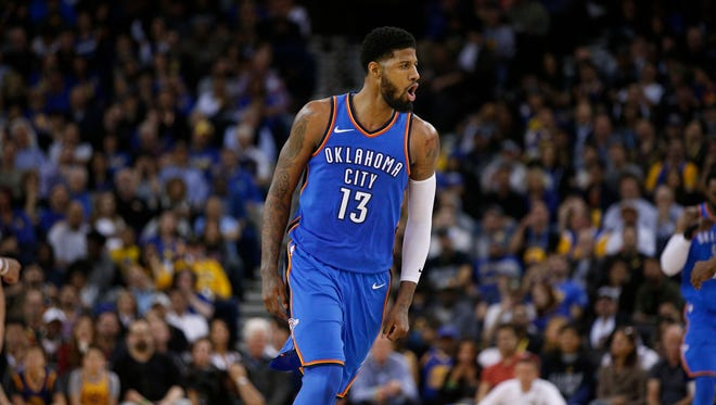 Oklahoma City Thunder forward Paul George (13) reacts after making a three point basket against the Golden State Warriors in the third quarter at Oracle Arena.