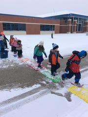 Students in Peter Dargatz's class prepare to snowshoe