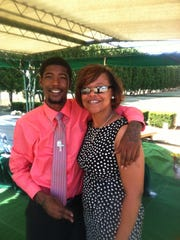 Antoine Terry, who was killed Dec. 27, is pictured with his mother, Erica Barnes. Barnes said Terry's probation kept him from receiving help at a Massachusetts drug rehabilitation clinic, and she believes he'd still be alive today if he'd been allowed to go.