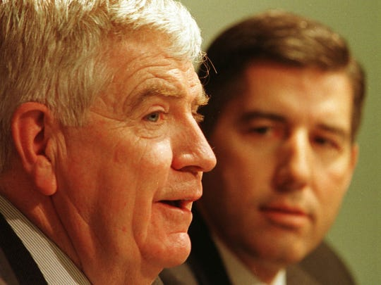 Former Iowa basketball coach Tom Davis, left,  announces that he'll resign after next season. At right is former UI athletic director Bob Bowlsby.