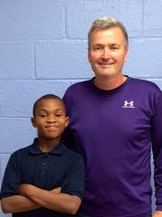 Bill Carmody, right, poses with one of his first students, Ra'Zhon McNeil, at the Boys and Girls Club.