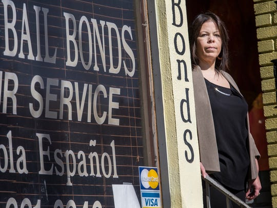 Bruny Mercado poses for a portrait outside her bail bonds office in Wilmington.