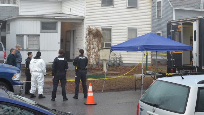 Investigators continue to work at 101 Elmwood Avenue in Burlington Wednesday morning following a fatal police-involved shooting Tuesday night during a drug raid.