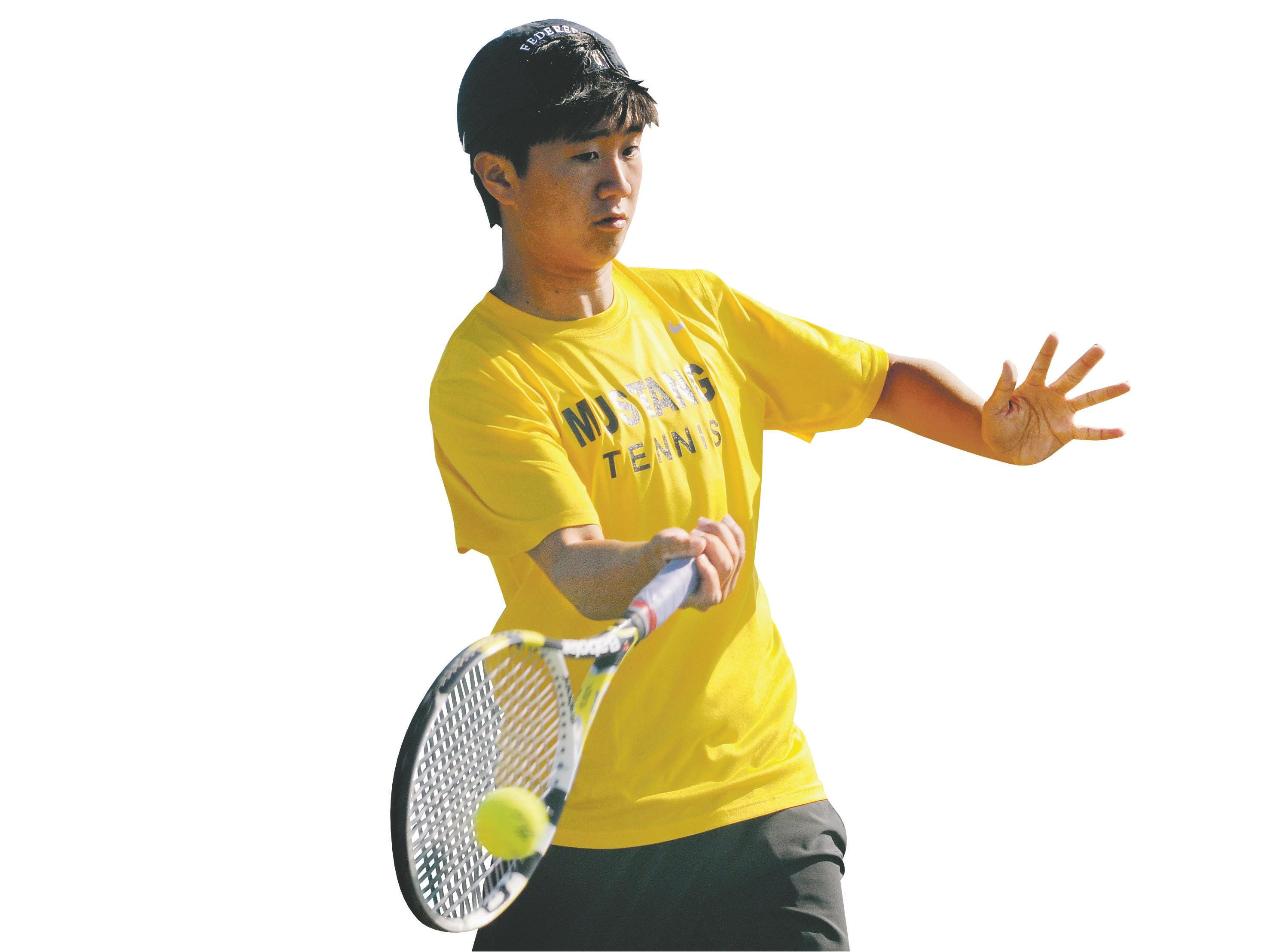 Albert Go of Titusville volleys with an opponent during a 2015 district tournament match.