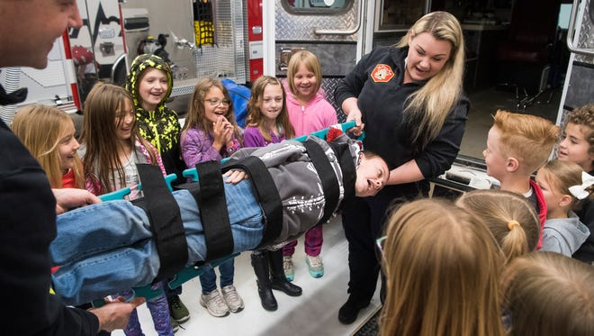 Emergency responders spin Bowen DeGraaf, 8, around on a support at the Cedar City Life Safety House on Wednesday, May 2, 2018. Elementary students from across the city learned about the warning signs of a fire, and what to do in an emergency.