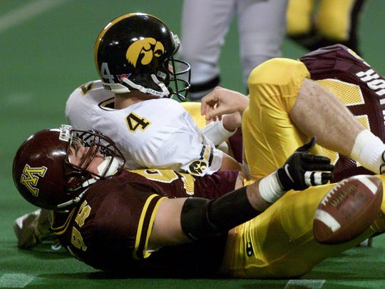 From 1998: Iowa quarterback is Kyle McCann is sacked
