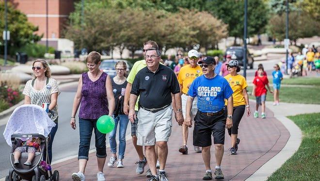 Participants walk along McKinley Avenue during a past CROP Hunger Walk.