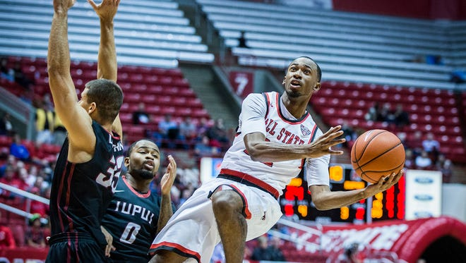 Ball State's Jeremie Tyler shoots past IUPUI's defense during their game at Worthen Arena Tuesday, Dec. 1, 2015.