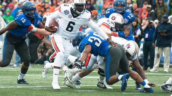 Auburn quarterback Jeremy Johnson (6) runs passed Memphis