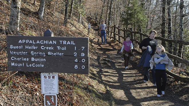 Day hikers come off the Appalachian Trail at the Newfound Gap parking area in the Great Smoky Mountains National Park.
