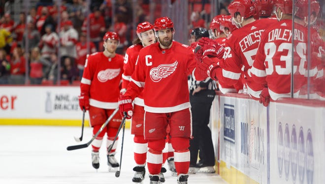 Detroit Red Wings center Henrik Zetterberg (40) celebrates with teammates after scoring a goal during the first period against the New York Islanders at Little Caesars Arena on April 7, 2018.