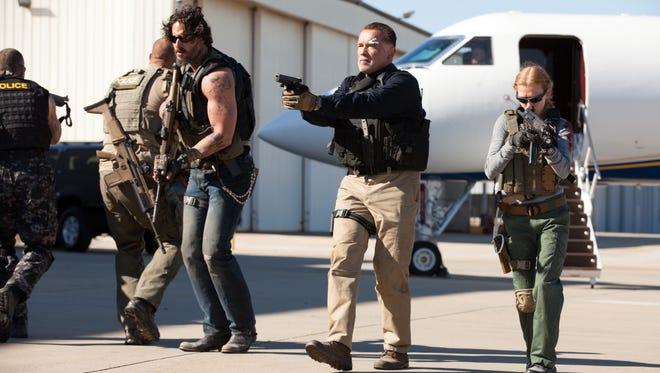 Joe Manganiello, left, Arnold Schwarzenegger and Mireille Enos star in the corrupt cop thriller 'Sabotage.'