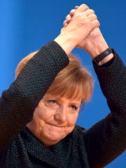 In this Tuesday, Dec. 9, 2014, file photo, German Chancellor