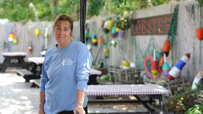 """Janet Demetri, owner of the Friendly Fisherman, a restaurant and seafood market in Eastham, relies on students on J-1 visas to keep her business going through the summer. She says her staff is about one-third of what it typically would be at this time of year. """"It's absolutely terrible,"""" she says."""