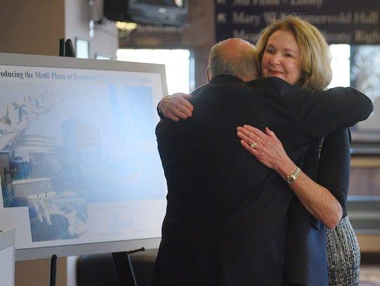 Craig Lloyd and Kathy Walsh unveil Metli Plaza in honor