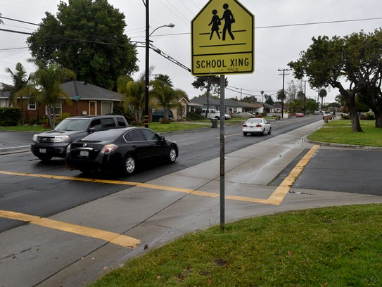 Cars pass through a busy intersection Tuesday near