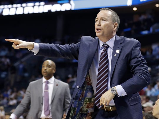 Texas A&M head coach Billy Kennedy directs his team against Providence during the first half of a first-round game in the NCAA men's college basketball tournament in Charlotte, N.C., Friday, March 16, 2018. (AP Photo/Gerry Broome)