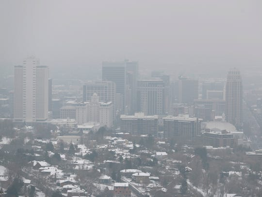 A temperature inversion traps and fills downtown Salt Lake City with thick smog on January 31, 2017.