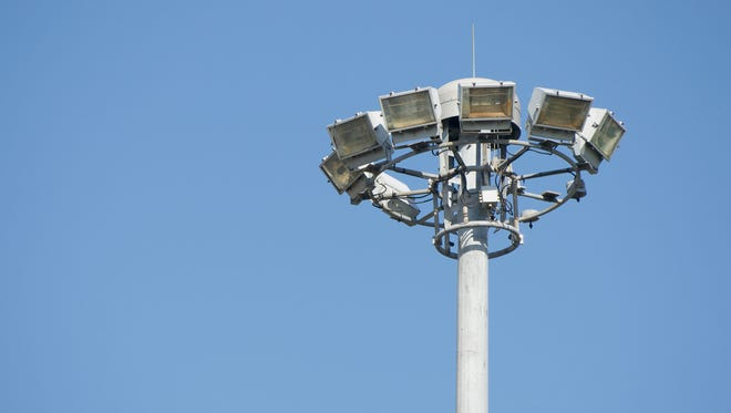 Lamps on high pole at super highway with blue sky.