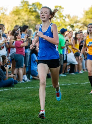 Whitefish Bay's Maggie Keiper finishes a race in 2016. She was part of Bay's smooth win in the North Shore Conference meet this fall.