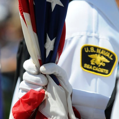 Sea Cadets color guard holds the American flag during