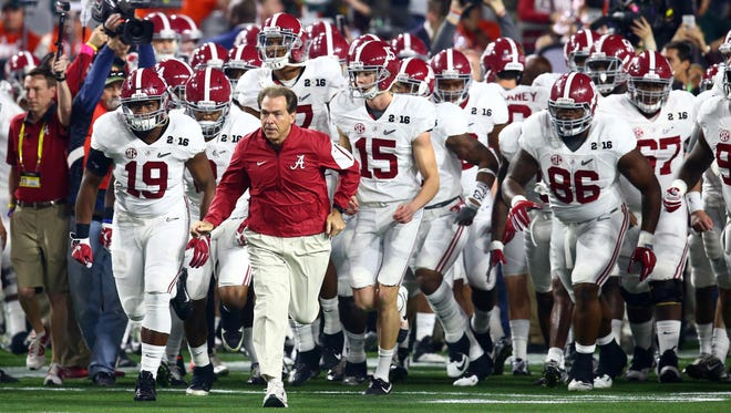 Alabama Crimson Tide head coach Nick Saban leads his team to the field before the 2016 CFP National Championship against the Clemson Tigers at University of Phoenix Stadium.