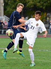 Franklin's Andrew Barterian (left) battles a Crestwood player for possession.