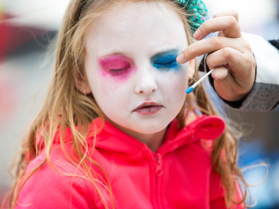 Khloe Herman, 7, of Las Cruces, gets her face painted
