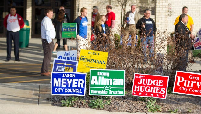 A pack of campaigners work a polling location at Holy Spirit Catholic Church, one of the largest in Fishers.