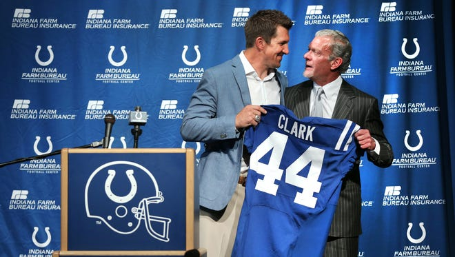 Former Indianapolis Colt tight end Dallas Clark shares a moment with Colts owner Jim Irsay after being given his jersey during a ceremony at the Indiana Farm Bureau Football Center on Wednesday, June 18, 2014. Clark has now retired from the NFL as an Indianapolis Colt.