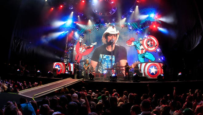 Brad Paisley performs at Darien Lake in Darien, N.Y., Thursday, July 3, 2014. A woman recently claimed police kicked her out of Paisley's San Diego concert Thursday night for breastfeeding.