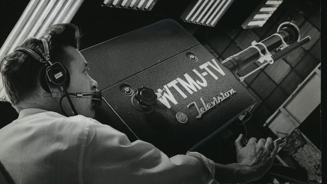 A camera operator aims a then-new television camera at WTMJ-TV studios in Milwaukee in this 1949 photo.