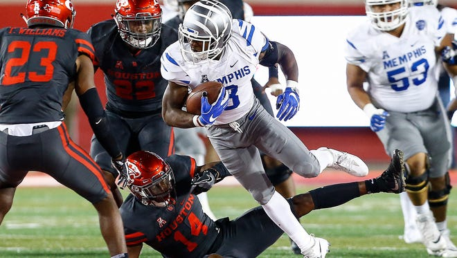 University of Memphis receiver Anthony Miller (middle) fights for a first down against the University of Houston defense during second quarter action in Houston, Texas., Thursday, October 19, 2017.