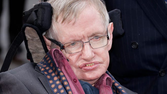 In this March 30, 2015, file photo, Professor Stephen Hawking arrives for the Interstellar Live show at the Royal Albert Hall in central London.