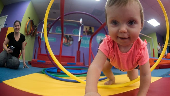 Lucia Worrell, explores the world at The Little Gym on Sorrento Road, as her mother, Heather, looks on Thursday, June 28, 2018.