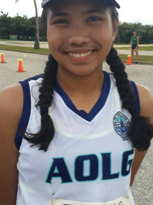 AOLG Junior Sheila Dumaraog, 1st place finisher for girls at 26:33 in a cross country meet against the George Washington Geckos.