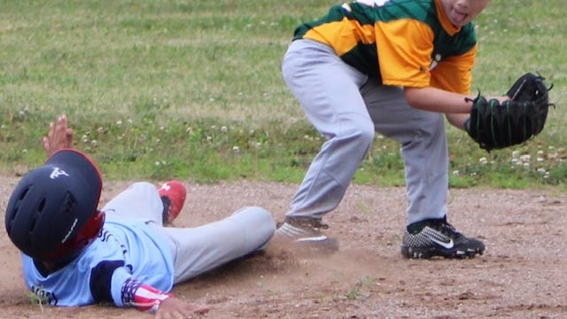 Lance Noel of the Blue Sox slides in to second base as Athletics infielder Mason Whitacre attempts to make the play. Tribune photos by Chapin Jewell