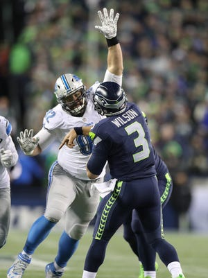 Haloti Ngata rushes Seahawks quarterback Russell Wilson during the third quarter of the Lions' 26-6 loss in the playoffs in Seattle on Jan. 7, 2017.