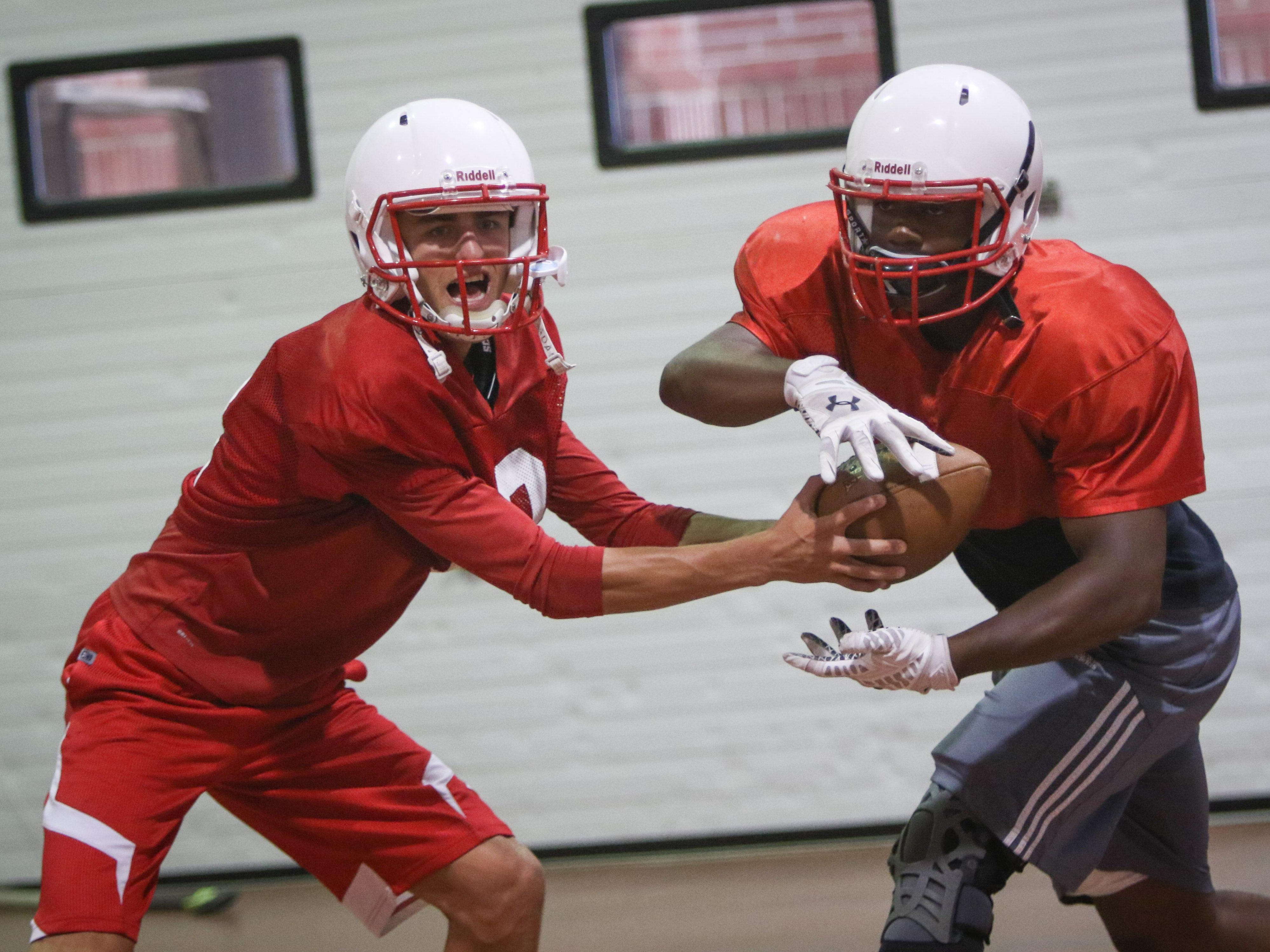 Quarterback Nolan Henderson and running back Will Knight lead a high-powered Smyrna offense against Salesianum on Friday night.